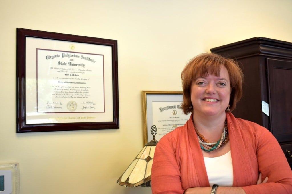 Sheri McGuire with Diplomas