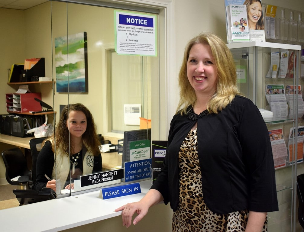 Amie Boone with receptionist