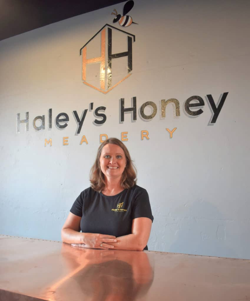 Haley with meadery sign